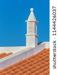 graceful white chimney on roof... | Shutterstock . vector #1144426037