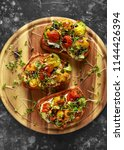 healthy toasts with baked sweet ... | Shutterstock . vector #1144426394