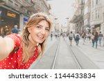 beautiful woman in red dress... | Shutterstock . vector #1144433834
