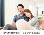 couple full of affectionate... | Shutterstock . vector #1144463687