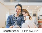 couple full of affectionate... | Shutterstock . vector #1144463714