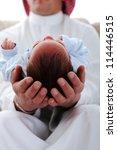 Arabic Man Holding A Newborn...