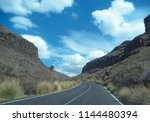 mountain road among rocks  gran ... | Shutterstock . vector #1144480394