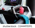 modern treadmill with blue... | Shutterstock . vector #1144495391