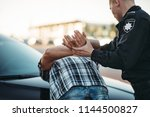 Police Officer Arrests The...