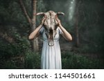 victim with skull of the animal ... | Shutterstock . vector #1144501661