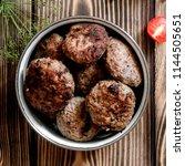 fried meat cutlets in a bowl... | Shutterstock . vector #1144505651