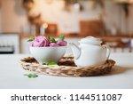 white teapot and pink dessert... | Shutterstock . vector #1144511087
