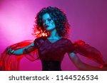 gothic girl in red. dancing... | Shutterstock . vector #1144526534