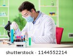 man chemist working in the lab | Shutterstock . vector #1144552214