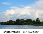 green island in a blue and... | Shutterstock . vector #1144625354