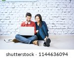 couple of students sitting on... | Shutterstock . vector #1144636094