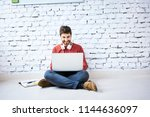 male student sitting on floor... | Shutterstock . vector #1144636097