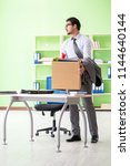 male employee collecting his... | Shutterstock . vector #1144640144