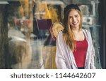 lifestyle fashion portrait of...   Shutterstock . vector #1144642607