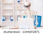skeleton businessman working in ... | Shutterstock . vector #1144651871