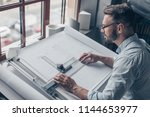 mature architect at the desk in ... | Shutterstock . vector #1144653977