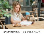 beatiful girl reading...   Shutterstock . vector #1144667174