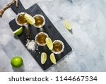mexican gold tequila with lime... | Shutterstock . vector #1144667534