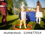 little boy inside the soap... | Shutterstock . vector #1144677014