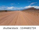 dirt road in namib naukluft... | Shutterstock . vector #1144681724