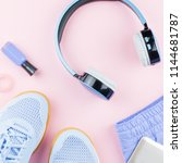 woman sneakers  headphones ... | Shutterstock . vector #1144681787