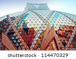 MACAU, CHINA - AUGUST 1, 2012: street view of Grand Lisboa Casino exterior on August 1, 2012 in Macau center. Macau is the gambling capital of Asia and is visited by over 25 million people every year - stock photo