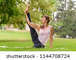 female adult yoga artist with... | Shutterstock . vector #1144708724