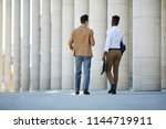 two young intercultural...   Shutterstock . vector #1144719911