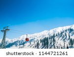 cable car at snow mountain in... | Shutterstock . vector #1144721261