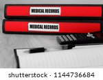 red folders with medical... | Shutterstock . vector #1144736684