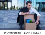 fired business man sitting... | Shutterstock . vector #1144746614
