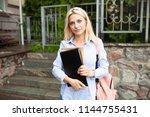 enthusiastic happy beautiful...   Shutterstock . vector #1144755431