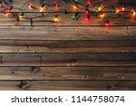 christmas garland lights on... | Shutterstock . vector #1144758074