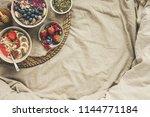 helthy breakfast in bed.... | Shutterstock . vector #1144771184