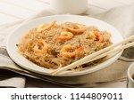 ellophane noodles stir fried... | Shutterstock . vector #1144809011