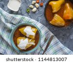 stuffed peppers on an old... | Shutterstock . vector #1144813007