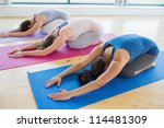 Women Doing Childs Pose In Yog...
