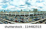 BANGKOK, THAILAND - AUGUST 12: parking lot and skyline next to Chatuchak Market on August 12, 2012 in Bangkok. Chatuchak weekend market is the largest in Thailand with 200,000 visitors per day - stock photo