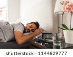 handsome young man sleeping... | Shutterstock . vector #1144829777