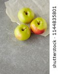 Apples Over Grey Stone Table....