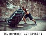 muscular bearded tattooed...   Shutterstock . vector #1144846841