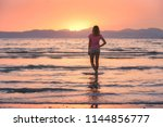 young woman standing in sea... | Shutterstock . vector #1144856777