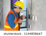 electrician working in the room ... | Shutterstock . vector #1144858667