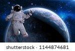 astronaut in space giving...   Shutterstock . vector #1144874681