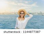 beautiful woman traveler stands ... | Shutterstock . vector #1144877387