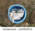 bucket of dirty rags on the...   Shutterstock . vector #1144902911