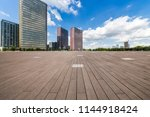 empty road with modern business ... | Shutterstock . vector #1144918424