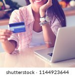 smiling woman online shopping... | Shutterstock . vector #1144923644