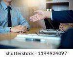 job interview for new staff in... | Shutterstock . vector #1144924097